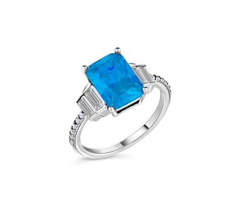 Aquamarine coloured ring in rhodium plating with clear crystals size 6