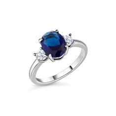 Oval cut blue ring with clear side stones in rhodium plating