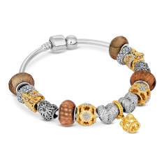 Charm Bracelet with Mixed Metal Charms on Solid Bangle
