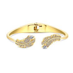 Feather bangle with crystals in gold plating